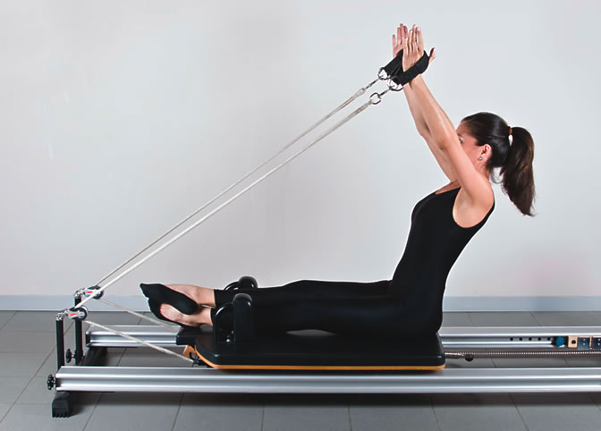 Woman on Pilates machine